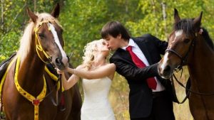Couple with horses at a Scots wedding